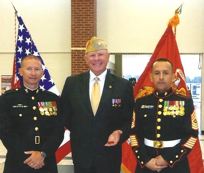 Lt. Col. John Heimburger and 2 Marines at a local high school ceremony
