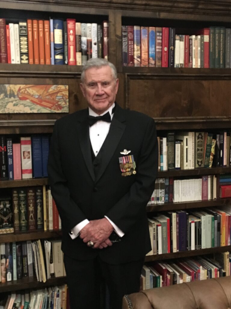 Colonel Hank Hoffman in a tuxedo with military ribbons