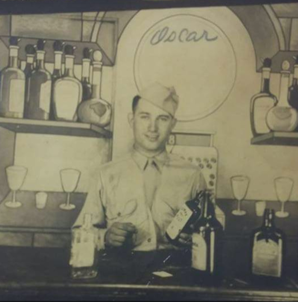 Oscar Green posing on a bar set in 1944