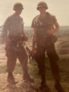 Color photo of Dave Himmer and another soldier in Vietnam