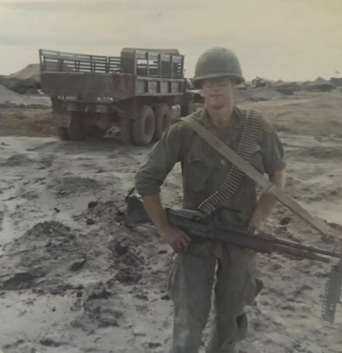 Dave Himmer in Vietnam with an M60 machine gun