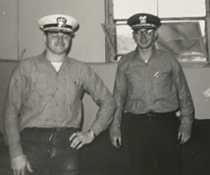 Gene (right) and friend trying on officers' covers