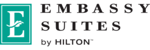 The green and black logo for Embassy Suites by Hilton
