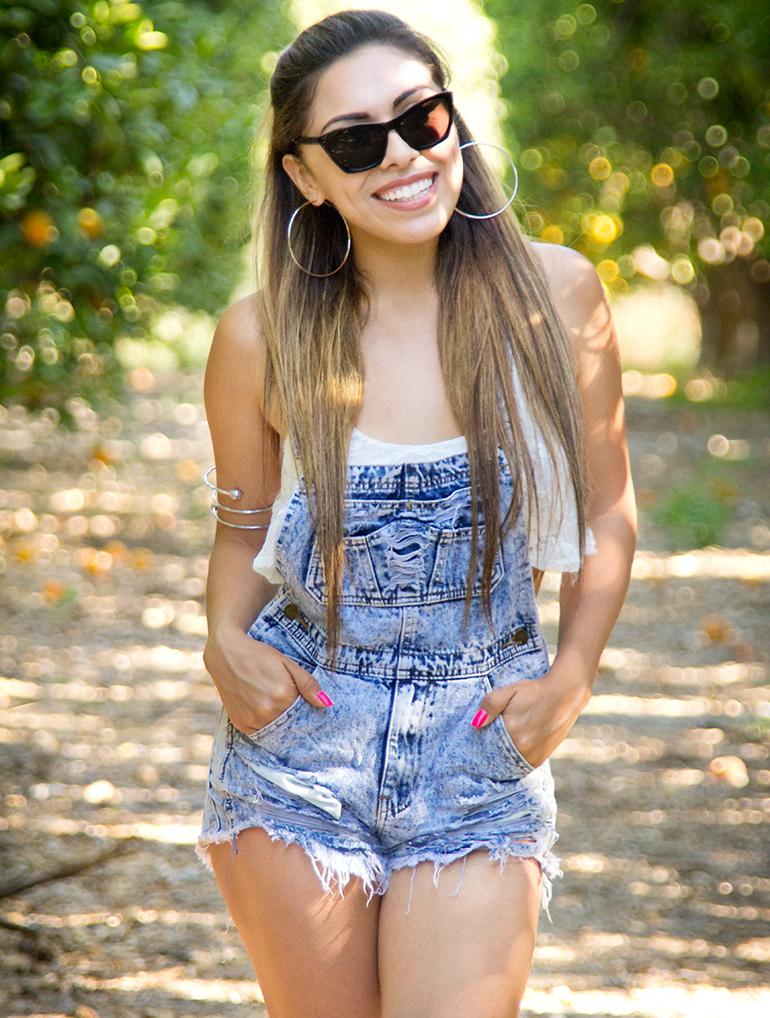 Alexis Alcala Posing in an Orange Grove in Denim Overalls