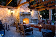 Quartzite stone fireplace and walls at twighlight