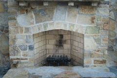 Quartzite fireplace and sandstone mantle