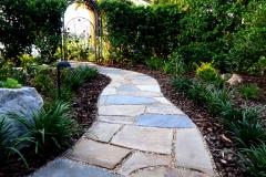 Flagstone path to backyard gate