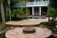 Backyard pool deck and firepit area
