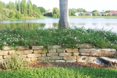 Dry-stack, tumbled stone retaining wall