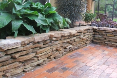 Stacked stone raised planter bed