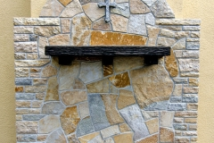 Quartzite wall with granite cross