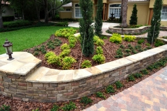 Natural and cultured stone retaining wall