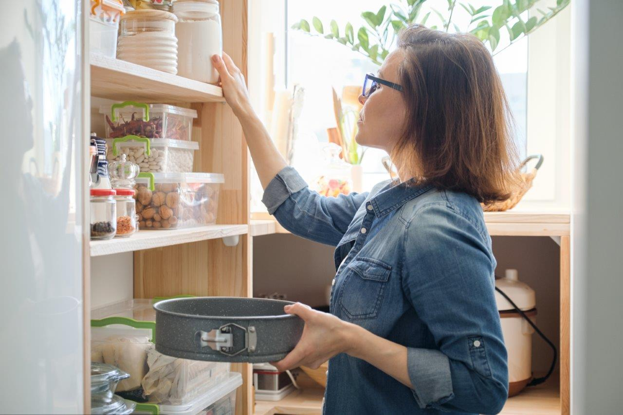 woman checking pantry