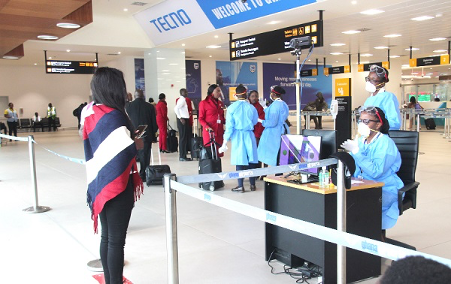 Kotoka International Airport with passengers going through security checkpoints