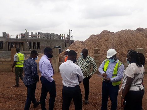 Officials of UKGCC listen to a site engineer's briefing during their tour of Appolonia's industrial park