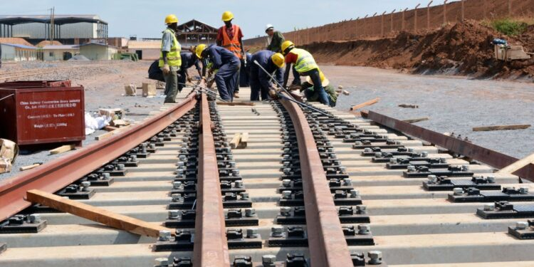 Railways workers maintaining a rail line