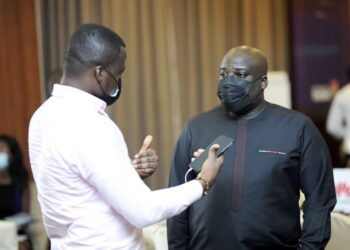 """Deputy Managing Director at Huawei Ghana, Mr. Kweku Essuman Quansah in a conversation with a journalist at the """"Huawei Day with the Media"""" held in Accra"""