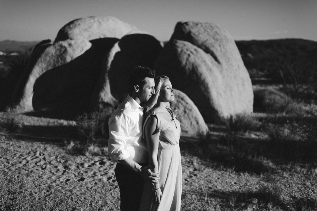 Black and white portrait of couple in Joshua Tree