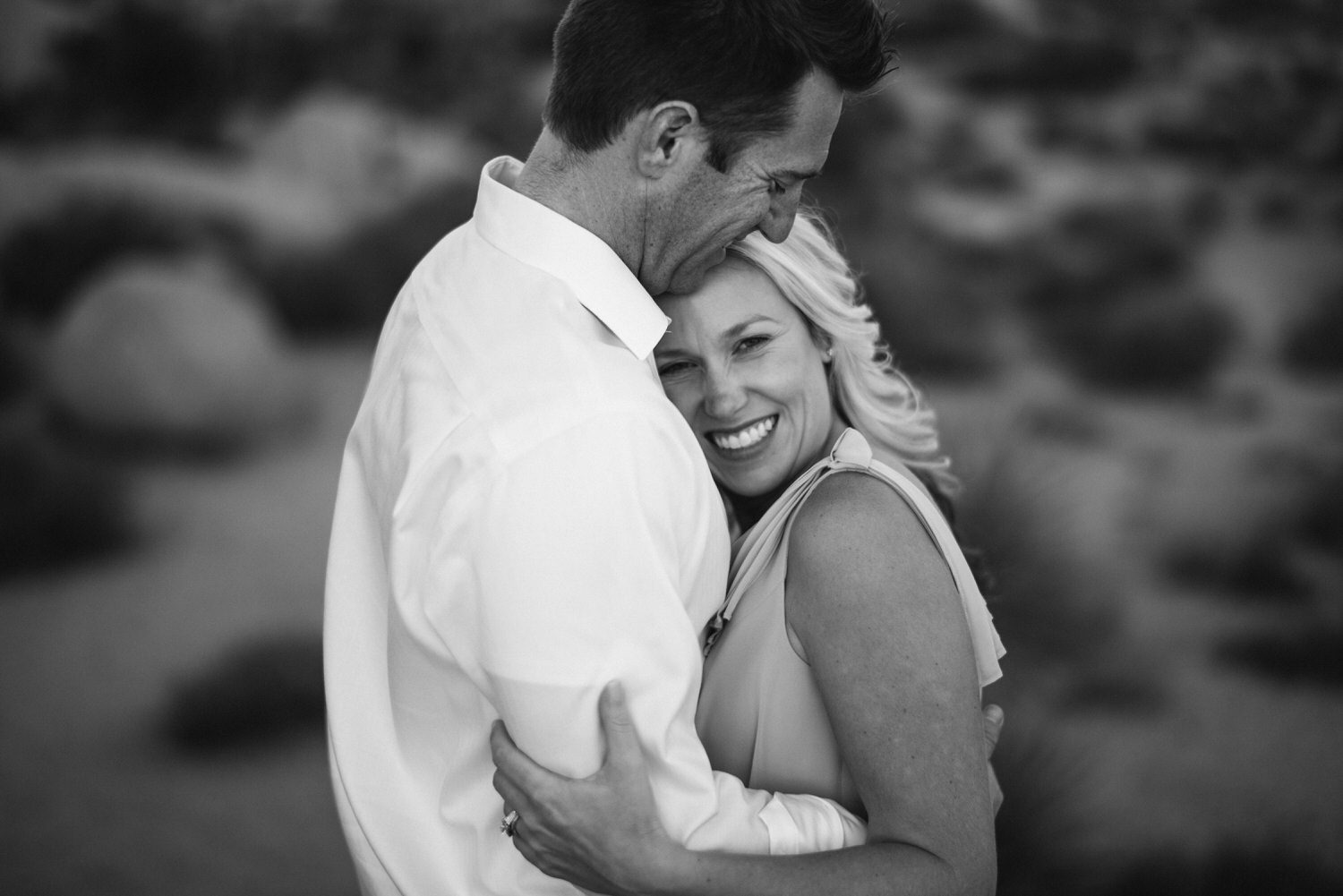 Tucson Engagement photographer capturing woman and man in the desert in love