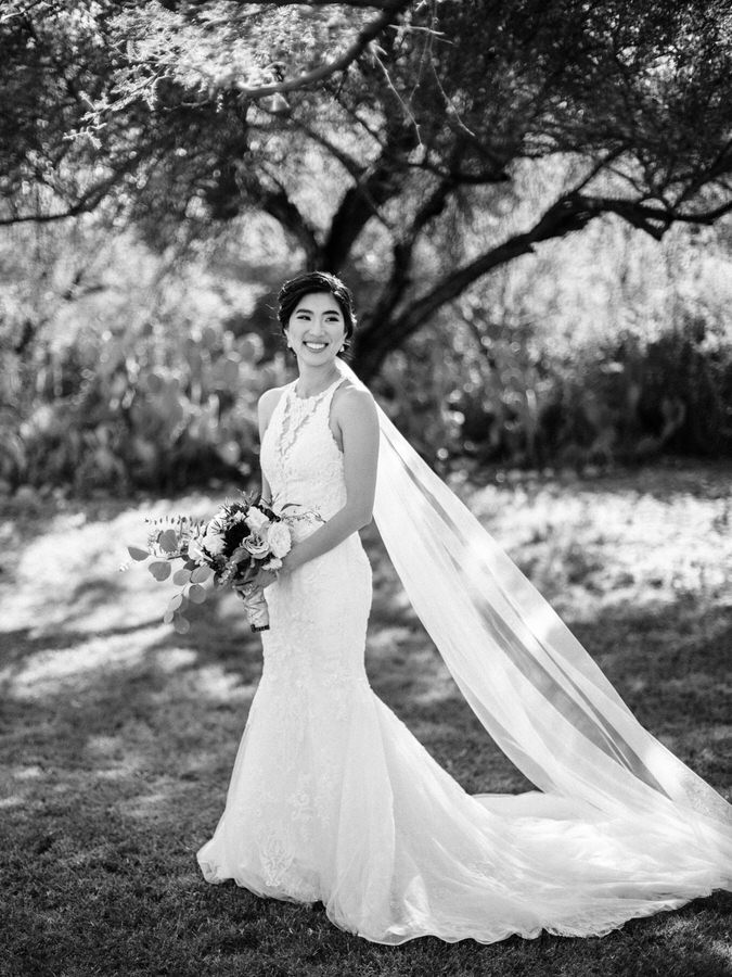 Black and white photo of bride on wedding day at Saguaro Lake Ranch under the trees