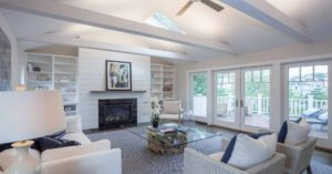 Sustainable can be beautiful. Salvaged hardwood floors, resilient windows, and highly efficient fireplace, make this room warm, inviting and green.