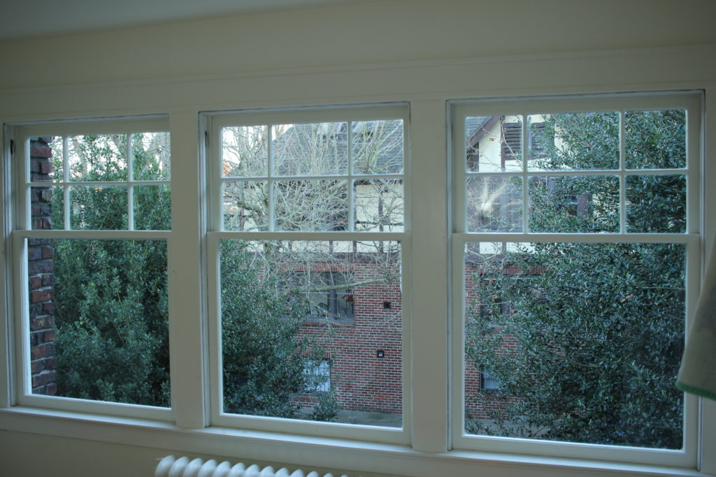 three white single pane double hung windows