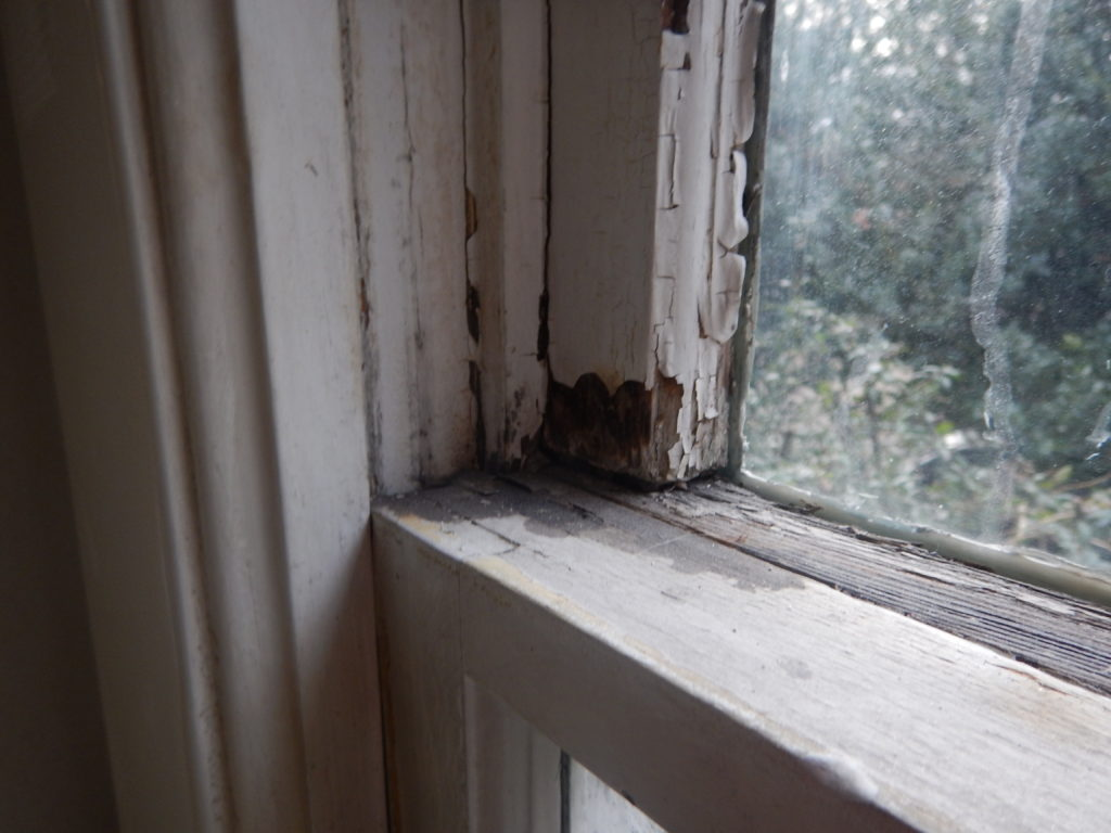 flaking paint from window