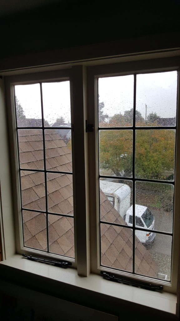 a closed out swing casement windows with zinc panels