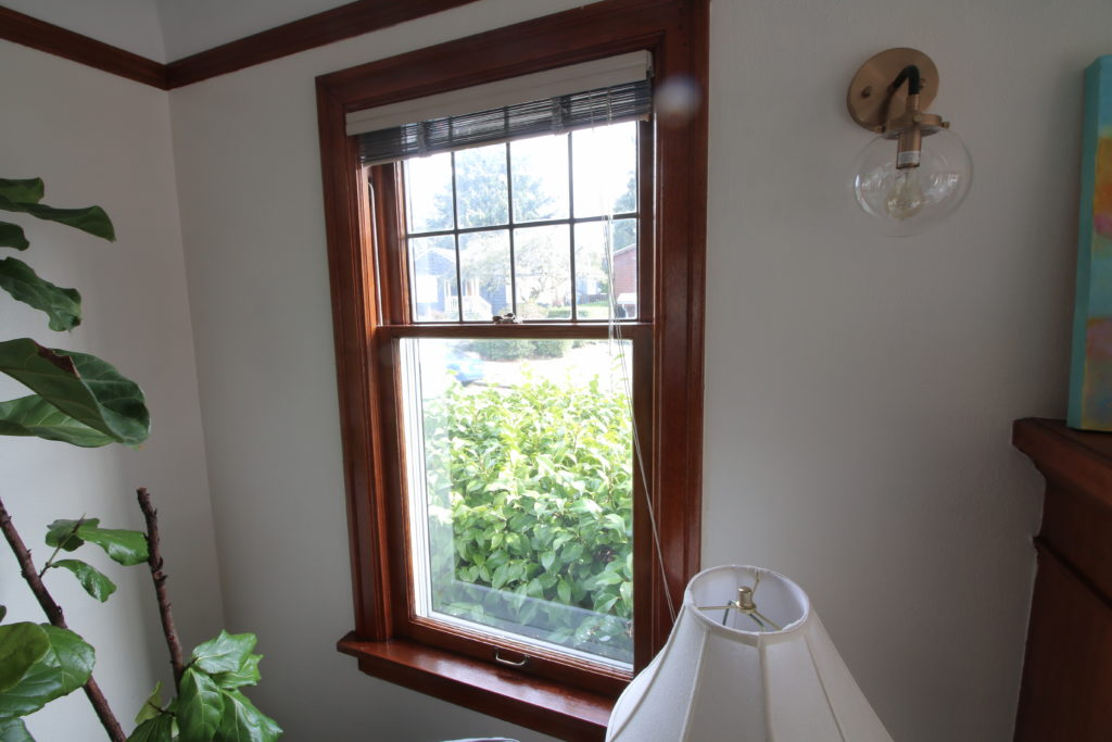 single single pane double hung window with shellac finish and zinc panel in upper sash