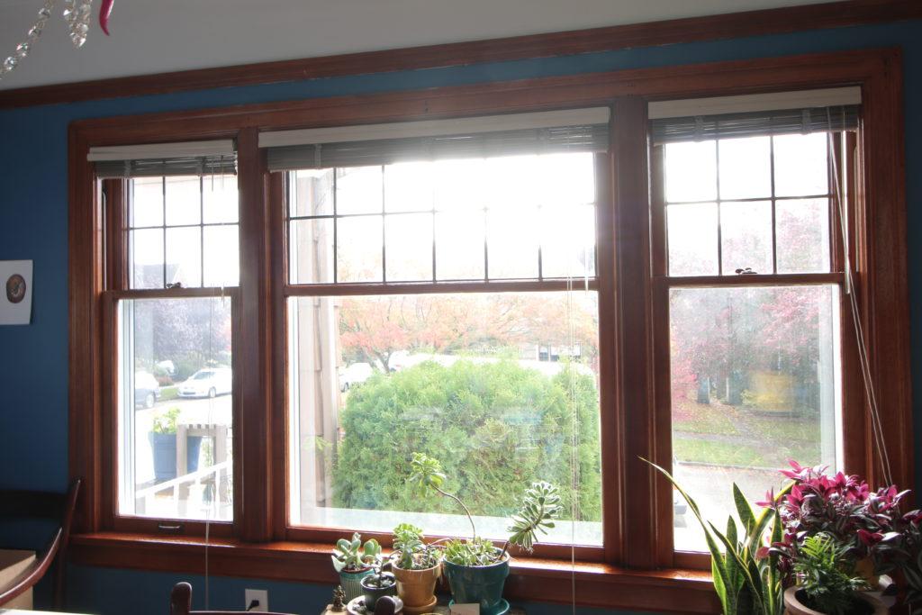 three restored windows with a amber shellac finish