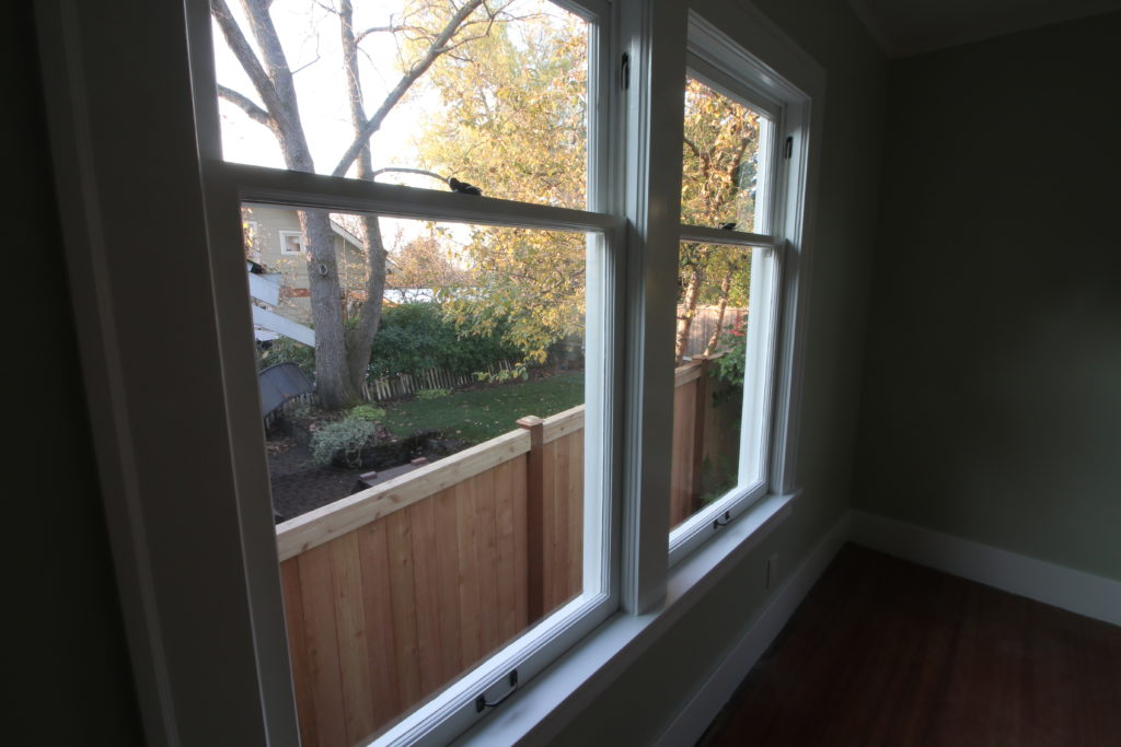 another side angle on two side by side double hung windows that have been fully restored.