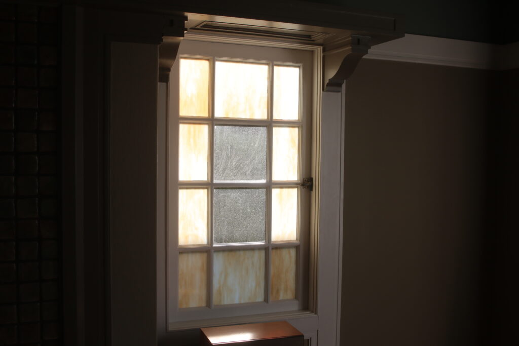 stained glass in wood casement window