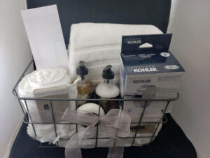 Luxurious towels, a shower head and lotion.
