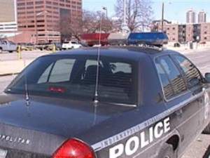 """This is an example of a fully marked IMPD police vehicle. Note the prominant display of """"Police"""" on the side and the police lights on top of the vehicle itself."""