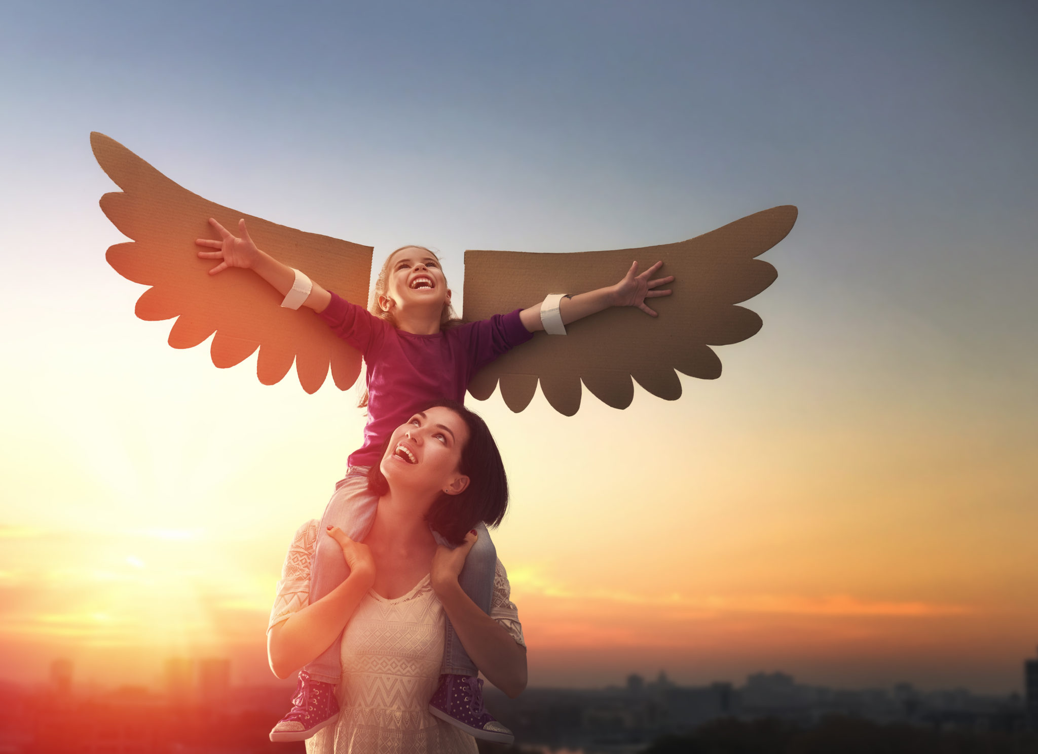 Mother and her daughter child playing together. Little girl plays in the bird. Happy loving family having fun.