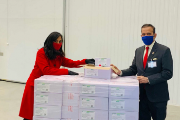 High Commissioner of India to Canada Mr. Ajay Bisaria, and Federal Minister of Public Services and Procurement Ms. Anita Anand receive the consignment of 500,000 Covishield vaccines from India at the Innomar warehouse in Toronto on March 3, 2021.
