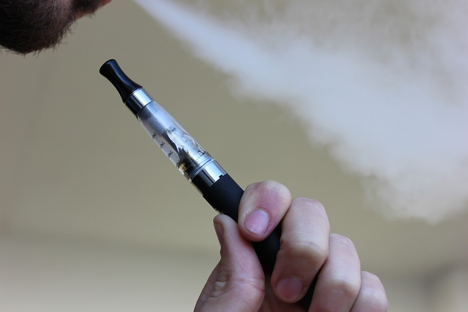person using a vaping device