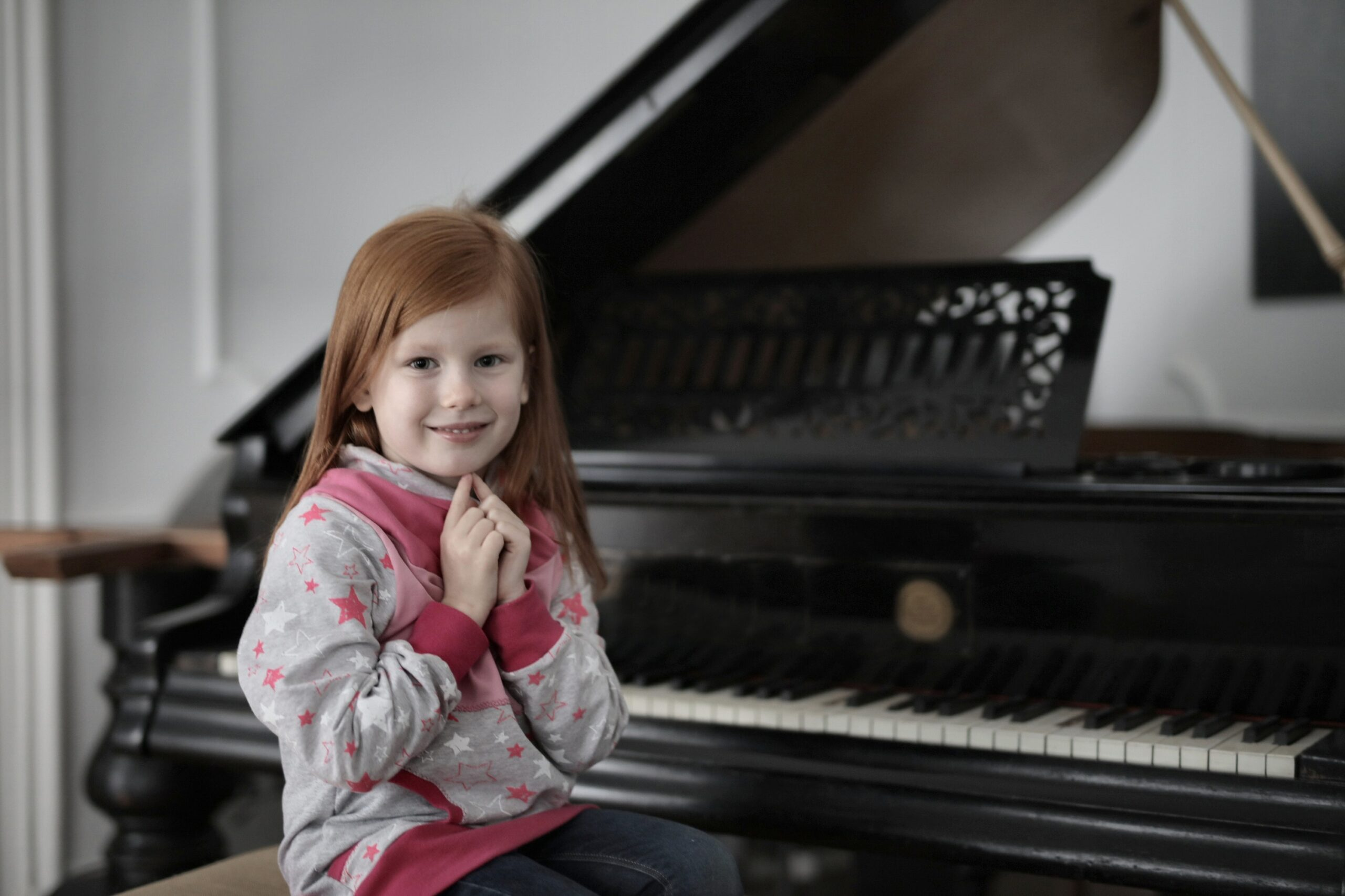 child taking piano lessons.