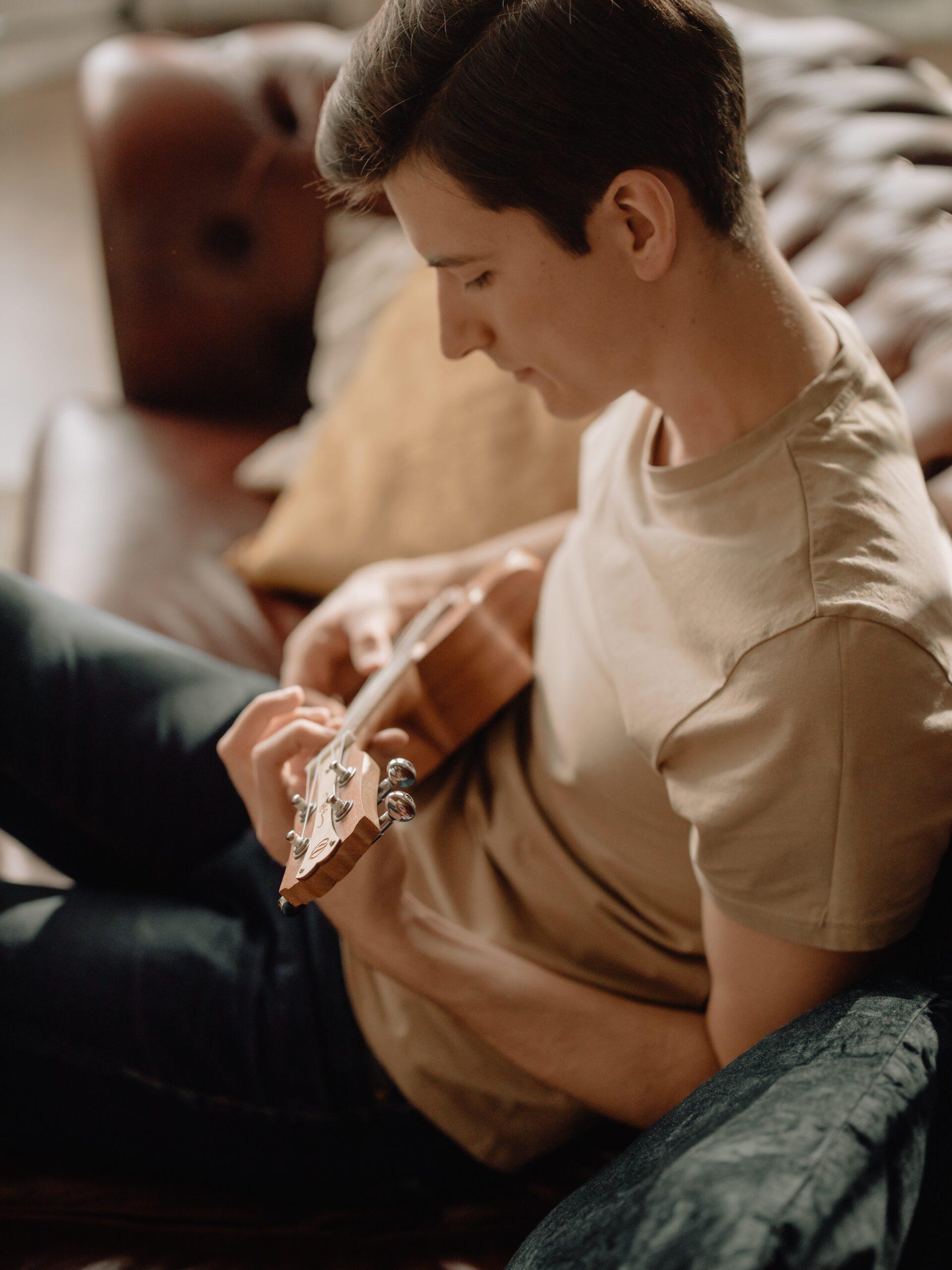 young man playing the ukulele.