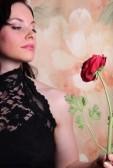3322075-beautiful-young-woman-holding-a-rose-studio-photo