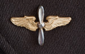1940s World War II gold insignia pin (airplane propeller and win