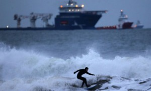 A surfer braves the waters of the North Sea off The Esplanade, Aberdeen