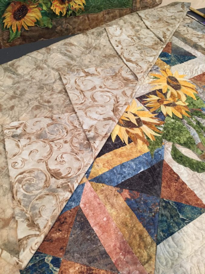 Image of 48-inch quilt with prairie points.