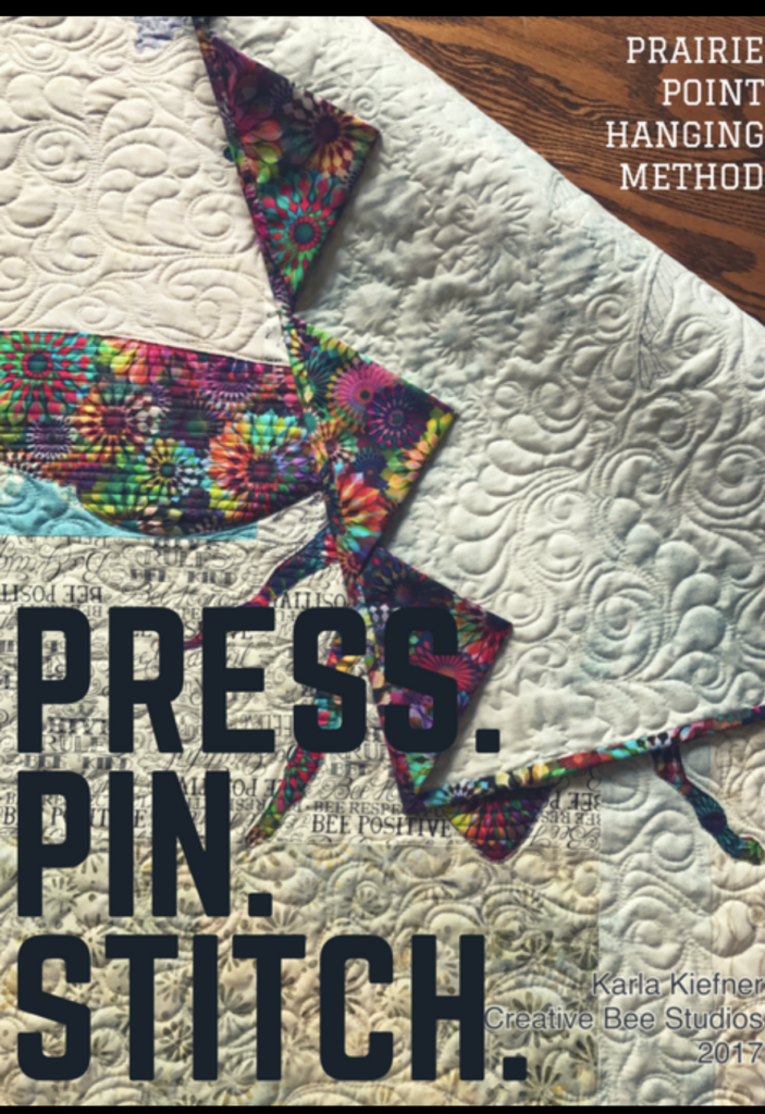 Image of quilt with words: Press. Pin. Stitch.