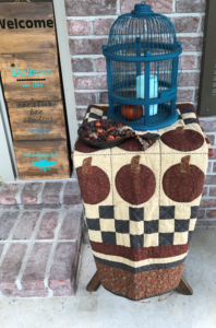 Image of quilt and bird cage