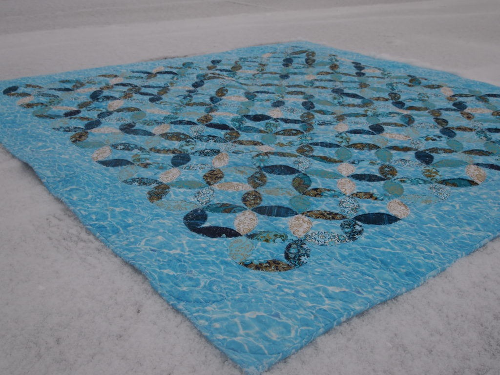 Image of Water Colours Quilt in the snow.