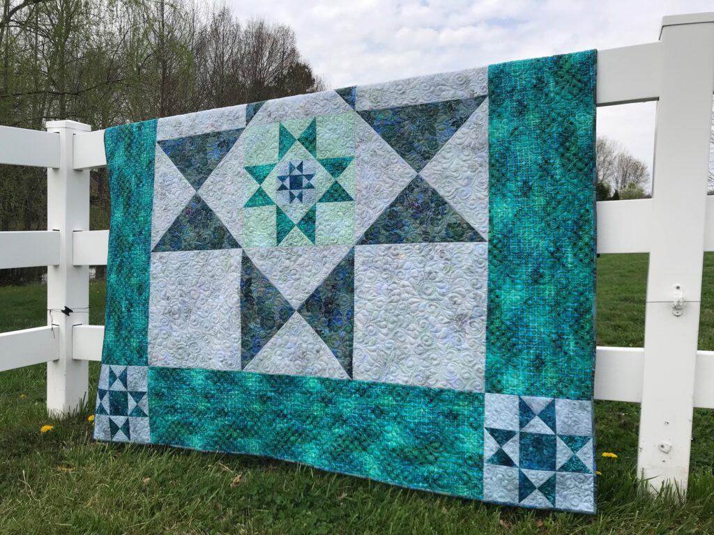 Image of Ohio Star Quilt Pattern made with classic Ohio Star block