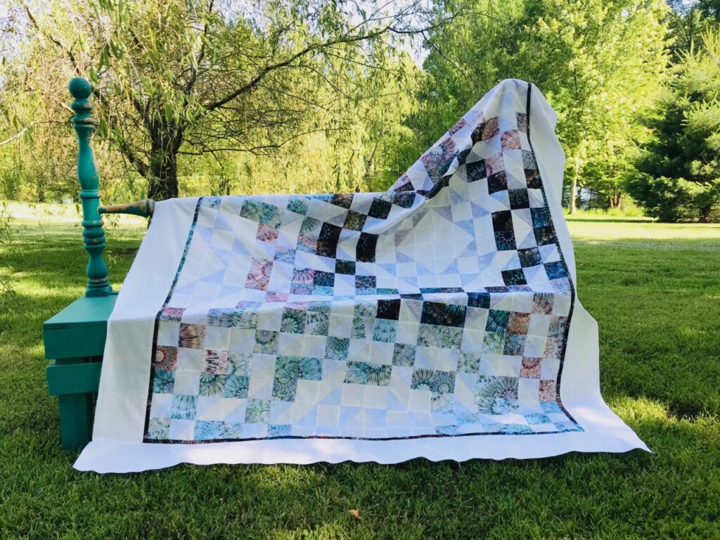 Image of Treasures quilt pattern using three new fabrics in this one-block quilt.