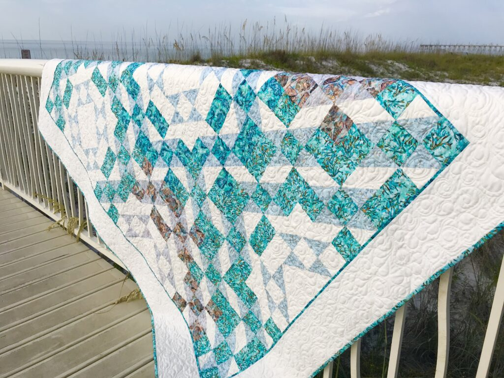 Image of one block quilt pattern at beach