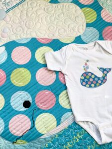 image of quilt and onesie